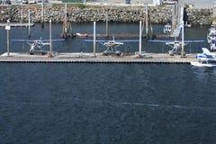 三架靠码头的浮游物飞机在Ketchikan,阿拉斯加 库存照片
