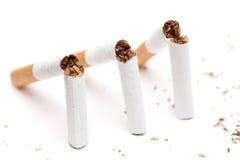 三根残破的香烟 库存图片