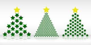 三棵圣诞树由星形制成 免版税库存照片