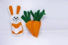 三棵毛毡红萝卜 免版税图库摄影