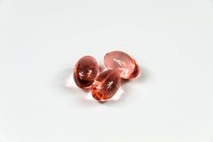三清楚的红色软的明胶胶囊 图库摄影