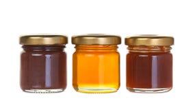 三瓶子果酱和蜂蜜 免版税库存图片