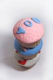 三甜点在白色的乳香树脂杯形蛋糕 图库摄影