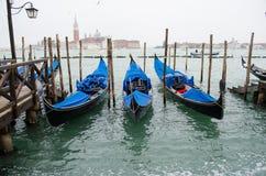 三艘长平底船在大运河的,意大利威尼斯 图库摄影