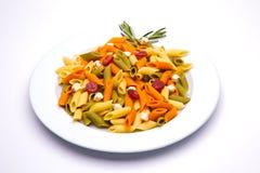 三色盘的意大利面食 图库摄影