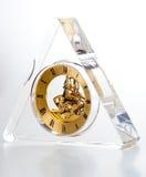 三角形状透明时钟 免版税图库摄影