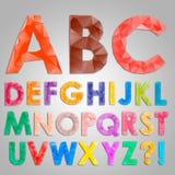 从三角的五颜六色的金刚石字体 免版税库存照片