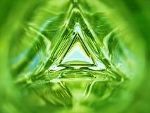 三角玻璃瓶鲜绿色颜色背景的里面的抽象图象 免版税库存照片