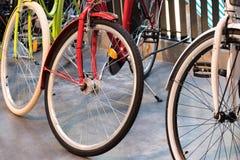 三辆五颜六色的自行车紧挨着 库存照片