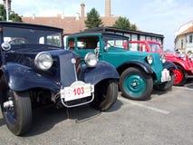 三辆历史的汽车 库存图片