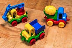 三辆塑料玩具汽车 免版税库存照片