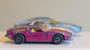 三辆老被打击的玩具汽车 库存照片