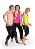 三逗人喜爱的妇女跳舞 免版税库存图片