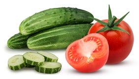 三黄瓜用切好的和整个蕃茄和一个切成了两半 库存图片