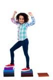 上升在笔记本的活跃女孩孩子 免版税库存图片