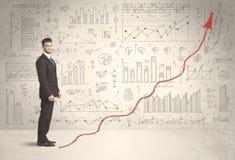 上升在红色图表箭头概念的商人 免版税库存图片