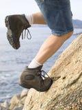 上升岩石的人 库存图片