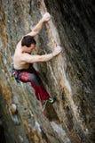 上升的风险岩石 库存照片