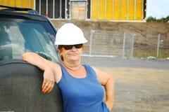 上司女性安全帽 免版税图库摄影