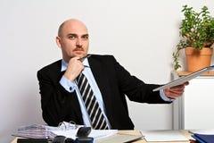 上司实施候选人钱包 免版税库存照片