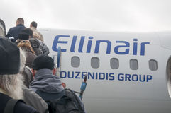 上在飞机上的人们 图库摄影