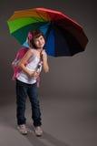 上学的逗人喜爱的小的女孩。 库存图片