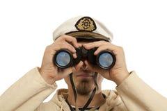 上尉通过看双筒望远镜 免版税图库摄影