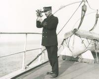 上尉驾驶的船 库存照片