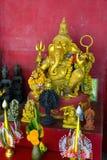 上帝Ganesha金雕塑有大象的头的 库存照片