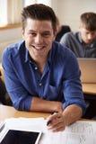 上成人教育类的成熟男学生画象  免版税图库摄影