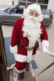 上有敞篷车的圣诞老人私人喷气式飞机 库存照片