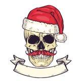 上色圣诞老人的手拉的恼怒的头骨 库存照片