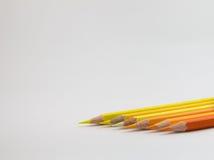 上色在白色背景的铅笔温暖的口气 免版税库存图片