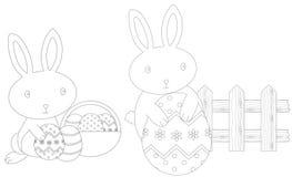 上色复活节的兔宝宝 库存照片