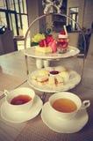 下午茶(被过滤的图象被处理的葡萄酒作用) 库存照片