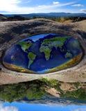 下来增长世界 免版税库存照片