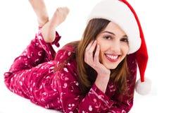 下来女孩位于的放松的圣诞老人微笑 库存图片