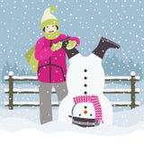 下来女孩和雪人 免版税库存照片
