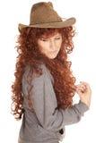 下来妇女红色头发帽子神色 免版税库存图片