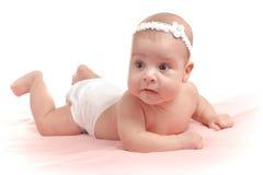下来婴孩女孩查出位于的一点 图库摄影