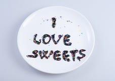 下来巧克力我书面的液体爱甜点 库存照片