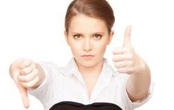 下来赞许和拇指 免版税库存图片