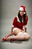 下来辅助工性感位于的圣诞老人 库存照片