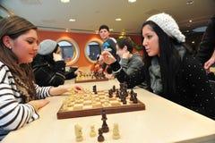 下棋的学生 库存照片