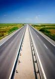 下蓝色高速公路天空 库存照片