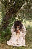 下跪在极度痛苦的耶稣在Gethsemane 库存图片