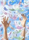 下雨落的手的欧元 库存照片