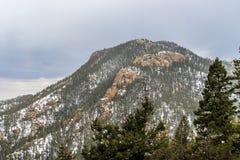 下雪在夏延山科罗拉多泉 库存照片