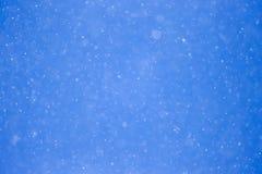 下雪在蓝天 免版税图库摄影