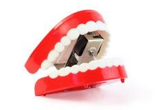 下颌结构被吞下的牙戏弄白色 免版税库存图片